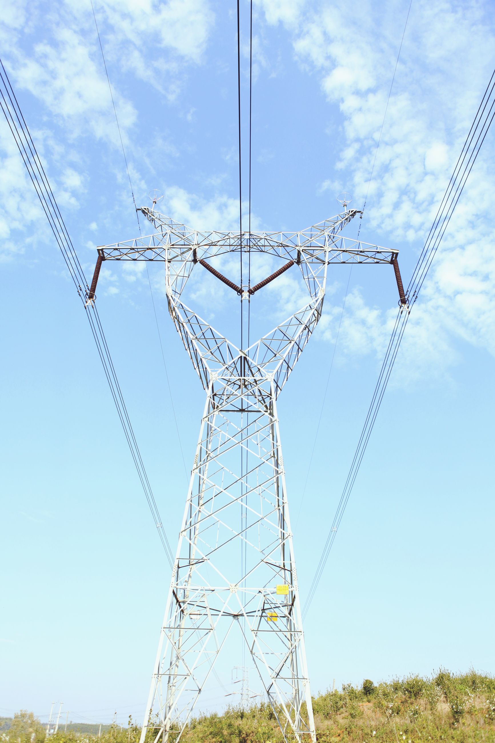 power supply, electricity pylon, power line, electricity, fuel and power generation, low angle view, connection, cable, technology, sky, power cable, blue, complexity, day, no people, outdoors, field, telephone line, cloud - sky, cloud
