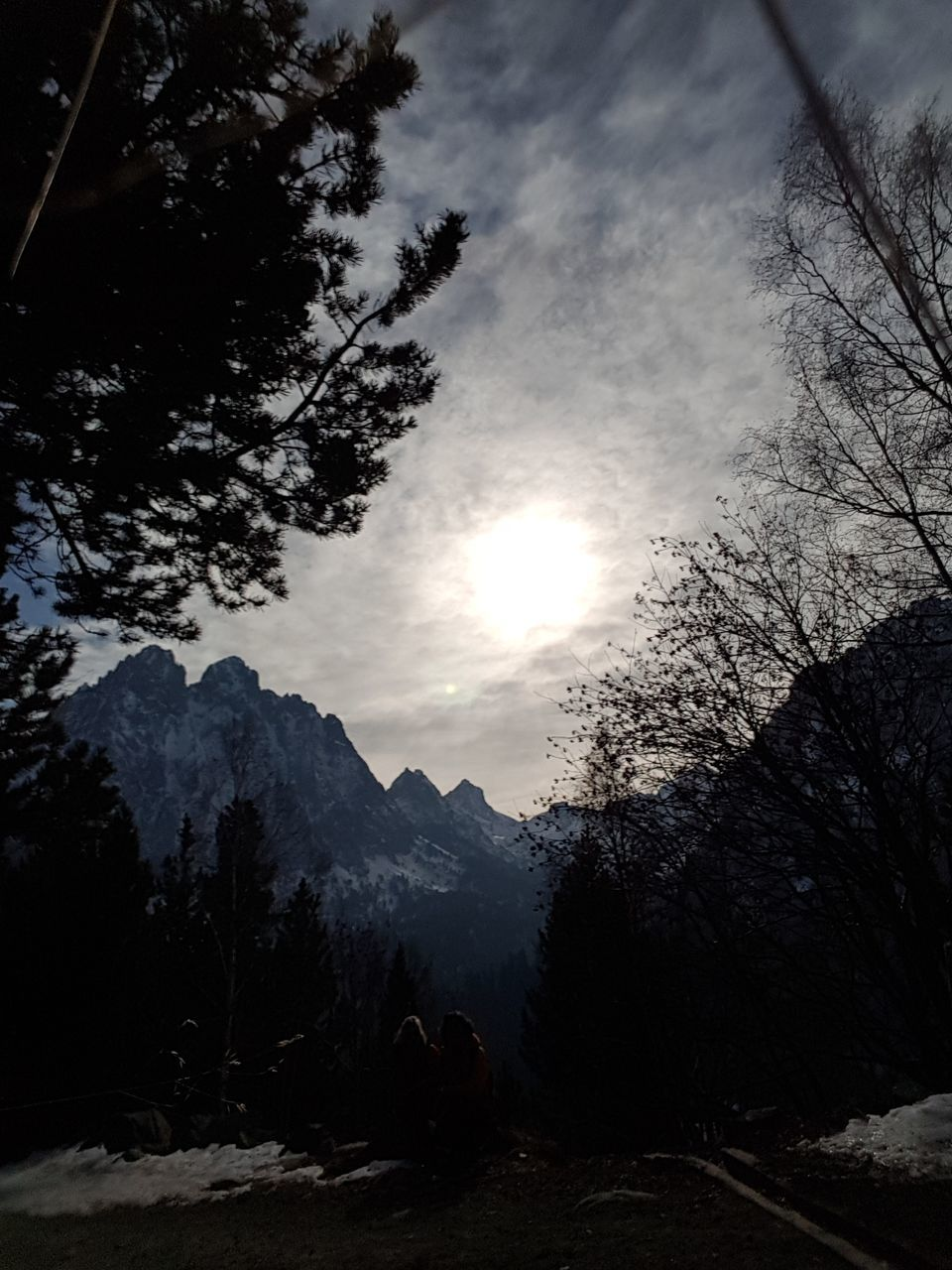 mountain, tree, nature, sky, silhouette, adventure, real people, beauty in nature, sun, sunset, tranquility, scenics, mountain range, outdoors, winter, men, day, people