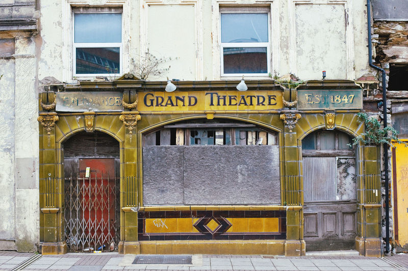 Abandoned Grand Theatre pub, Plymouth Pub Abandoned Abandoned Buildings Architecture Bar Building Exterior Built Structure City Day Entrance Façade No People Outdoors Text Urban Decay Window Yellow