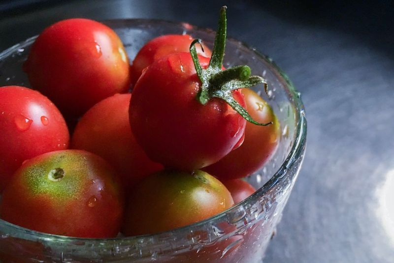Food And Drink Vegetable Freshness Healthy Eating Food Tomato Close-up Red No People Table Red Bell Pepper Focus On Foreground Fruit Indoors  Day Nature Tomatoes