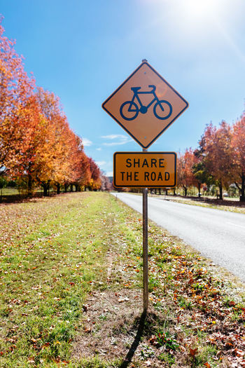 Stanley, Victoria SafeYourHead Autumn Bike Change Communication Cycling Day Direction Guidance Information Nature No People Outdoors Plant Road Road Cycling Road Sign Share The Roadf Sign Text The Way Forward Transportation Tree Warning Sign Western Script