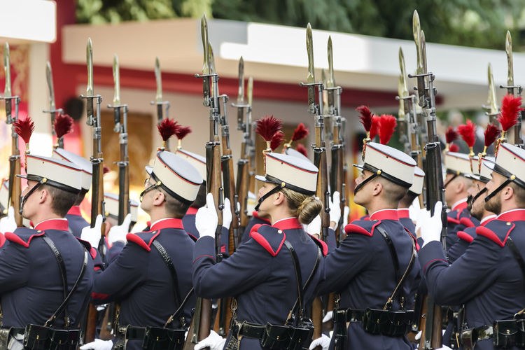 Royal Guard soldiers with rifle raised on parade during the 12 October 2017 - Fiesta Nacional de España (National Day of Spain), Madrid Spain. Hair National Day National Day Parade Uniform Woman Hairstyle In A Row Men Military Parade Military Uniform National Day Celebrations On Parade People Performance Real People Red Rifles Royal Guard Saluting Standing Uniform Women