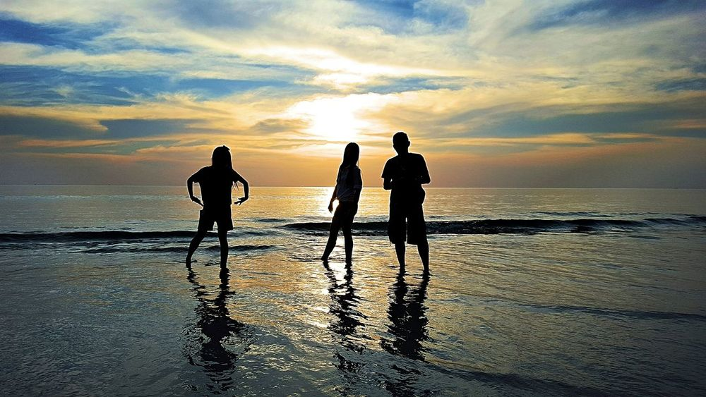 Beach Sunset Sea Cloud - Sky Reflection Sky Togetherness Bonding Silhouette Water Outdoors Two People Real People Dramatic Sky Beauty In Nature People Friendship Men Nature Adult