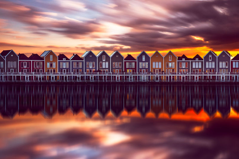 Amsterdam EyeEm Best Shots EyeEm Selects EyeEmNewHere Remo SCarfo Architecture Beauty In Nature Building Building Exterior Built Structure Cloud - Sky Dramatic Sky Holland In A Row Land Nature No People Orange Color Outdoors Reflection Scenics - Nature Sea Sky Sunset Water