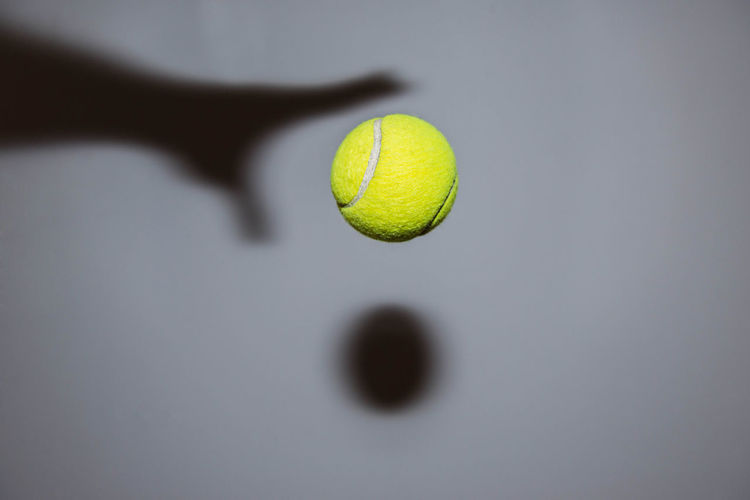 Close-Up Of A Shadow And A Tennis Ball