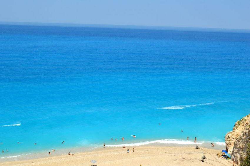 Milos beach in Lefkada Beach Beauty In Nature Blue Coastline Day Enjoyment Horizon Over Water Idyllic Showcase July Lifestyles Mixed Age Range Nature Outdoors Scenics Sea Shore Sky Summer Tourism Tourist Tranquil Scene Tranquility Travel Destinations Vacations Water