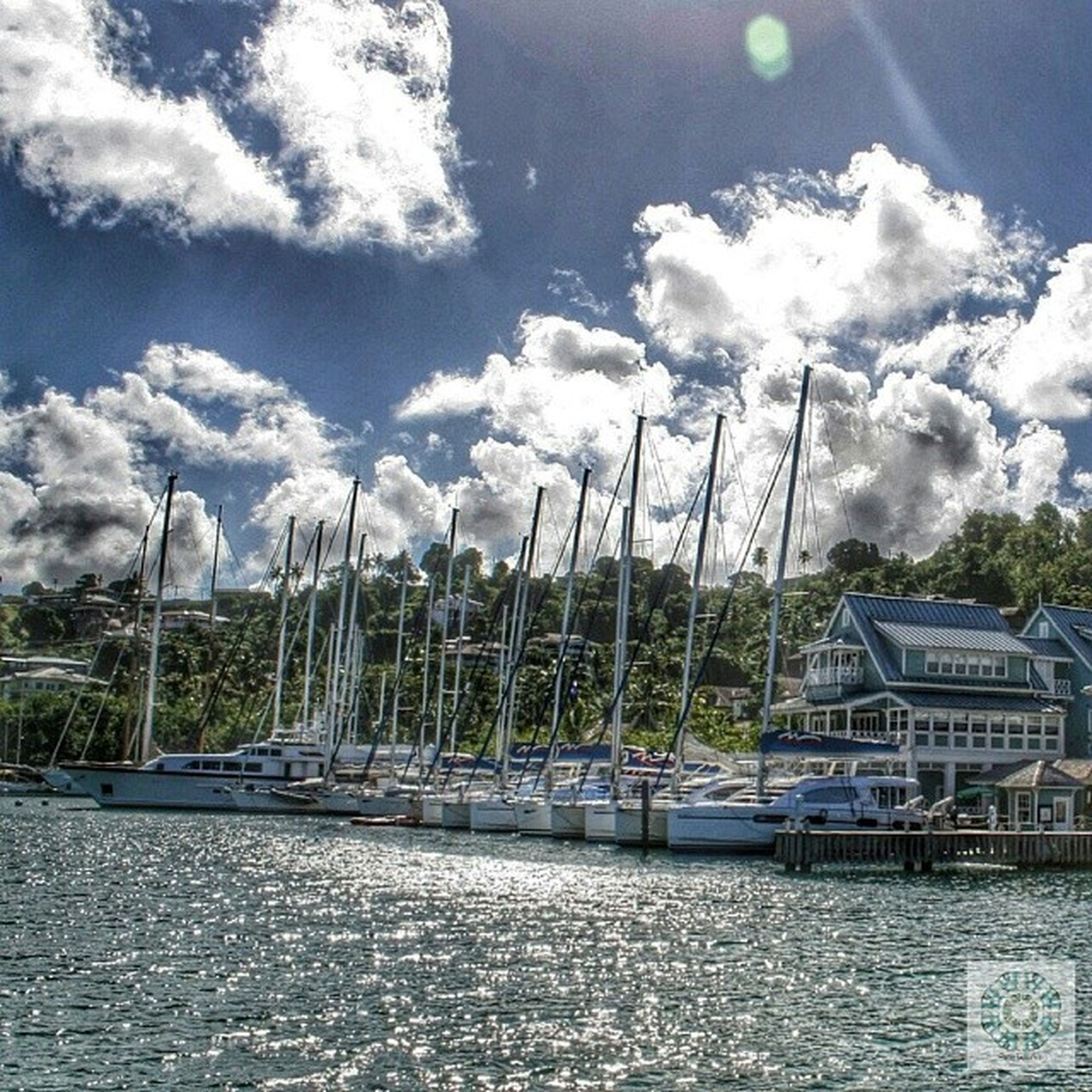 sky, water, cloud - sky, waterfront, cloudy, cloud, sea, nautical vessel, built structure, harbor, river, nature, day, tree, transportation, outdoors, pier, blue, architecture, tranquility
