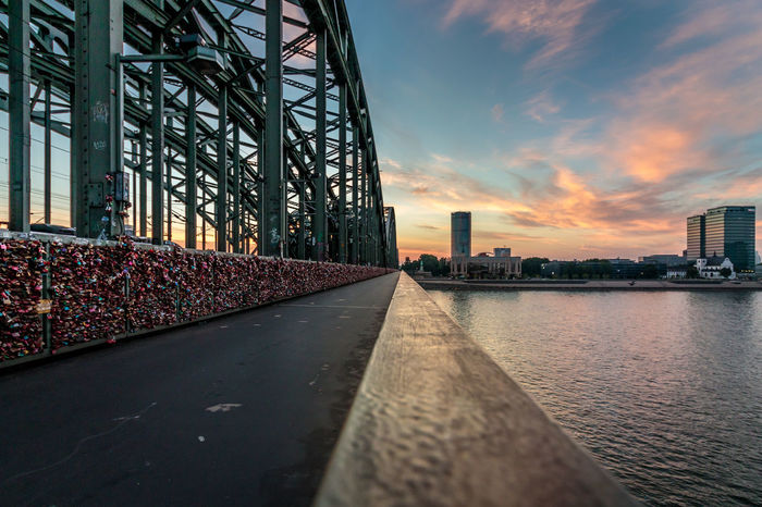 Sunset in cologne Cologne Cologne , Köln,  Locks Rhine Architecture Bridge - Man Made Structure Building Exterior Built Structure City Cloud - Sky Day Hohenzollernbrücke Love Locks Love Locks Bridge No People Outdoors Sky Steal Sunset Water