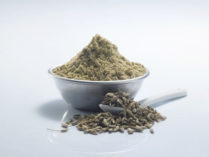 bowl of ground cumin on the white background Container Natural Seed Aroma Bowl Close-up Condiment Cumin Food Food And Drink Fragrance Freshness Ground - Culinary Healthy Eating Herb Herbal Medicine Ingredient No People Pile Seasoning Spice Spoon Still Life Studio Shot White Background