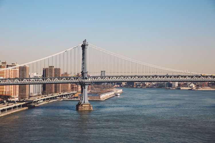 Architecture Bridge - Man Made Structure Business Finance And Industry City Cityscape Cold Connection Day December Manhattan Bridge New York New York City No People Outdoors River Sky Sunny Suspension Bridge Tourism Transportation Travel Travel Destinations Urban Skyline Water Winter