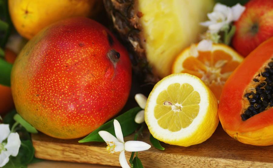 closeup of tropical fruits Mango Citrus Fruit Close-up Food Food And Drink Freshness Fruit Healthy Eating Lemon Orange Orange Color Papaya Red SLICE Table Wellbeing