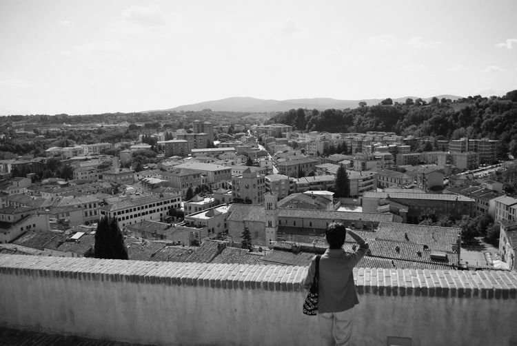 Viewpoint of Colle di Val d'Elsa, Tuscany, Italy. Architecture Blackandwhite Building Exterior Building Terrace Built Structure City Cityscape Cityscape Colle Di Val D'Elsa Day Italia Italy One Person Outdoors Siena Sky Toscana Town TOWNSCAPE Tuscany Urban Viewpoint