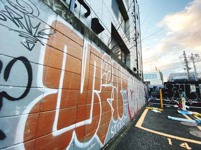 Graffiti on train against sky