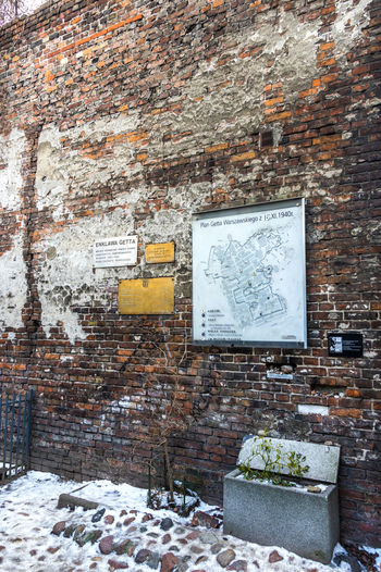 Preserved fragment of the Ghetto wall Architecture Attraction Brick Wall Built Structure Day Ghetto Wall Holocaust Jewish Jewish Memorial Landmark No People Outdoors Poland Shoah Sienna Sightseeing Symbol Warsaw