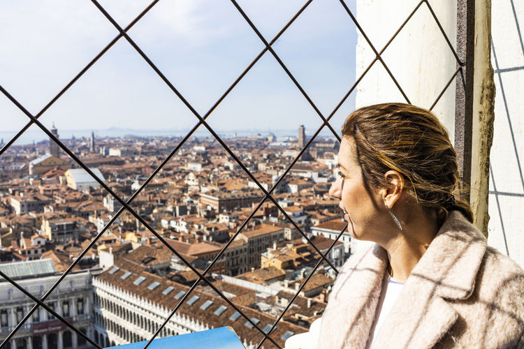 Portrait of man looking at cityscape