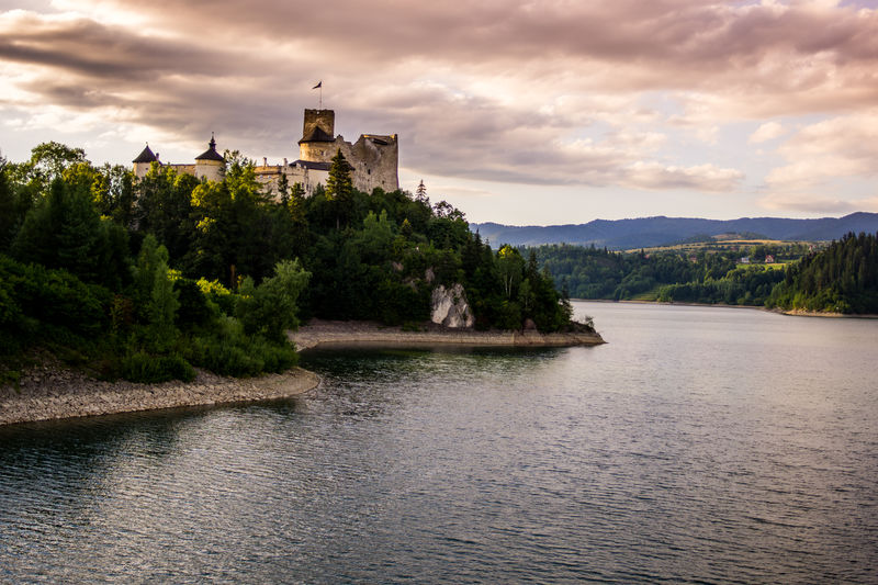 The Niedzica castle in Poland during a sunset. Architecture Built Structure Hill Lake Landscape Nature Niedzica Outdoors Poland Purple Sunset Water Waterfront