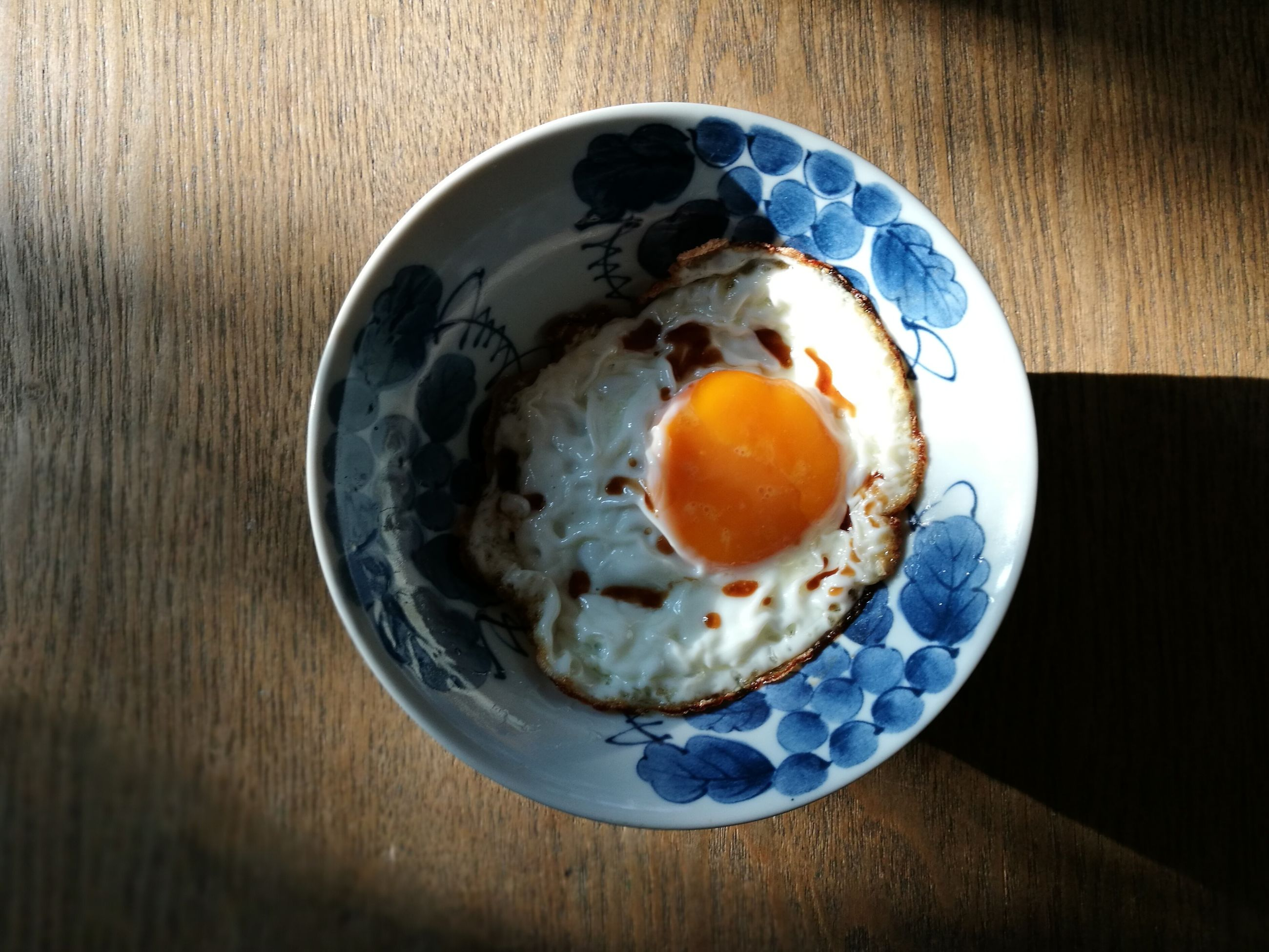 egg, food and drink, indoors, table, food, egg yolk, fried egg, breakfast, high angle view, no people, freshness, plate, directly above, ready-to-eat, healthy eating, close-up, sunny side up, day