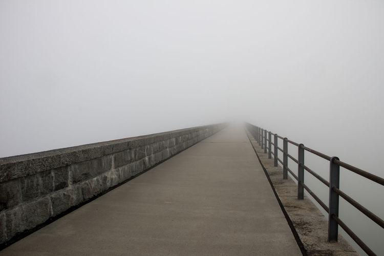 Dam at Räterichsbodensee with clouds rolling up Grimsel Valley, Berner Oberland, Switzerland Architecture Background Disappearing Clouds Clouds Rolling In Dam Fog Grey Grey Day Leading Lines Masonry No People Poor Visibility Structures & Lines Visibility Wall