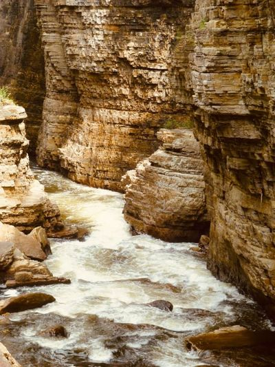 Rock Beauty In Nature Scenics - Nature Solid Motion Rock - Object No People Water Rock Formation Nature Travel Destinations Day Flowing Flowing Water Non-urban Scene Geology Outdoors Waterfall Blurred Motion Eroded Canyon