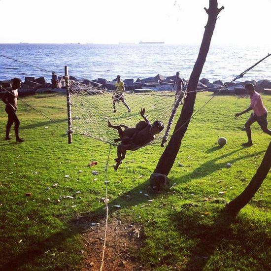 Children swinging while other playing football at Potenga sea beach in Chittagong ! Js Jashimsalam Photographer Photojournalist Documentary Dailylife Swing Children Play Football Beach Whpfilltheframe Instagram Potenga Boat Ship Sea Green Water Port Chittagong Bangladesh Chottogram Everydaybangladesh