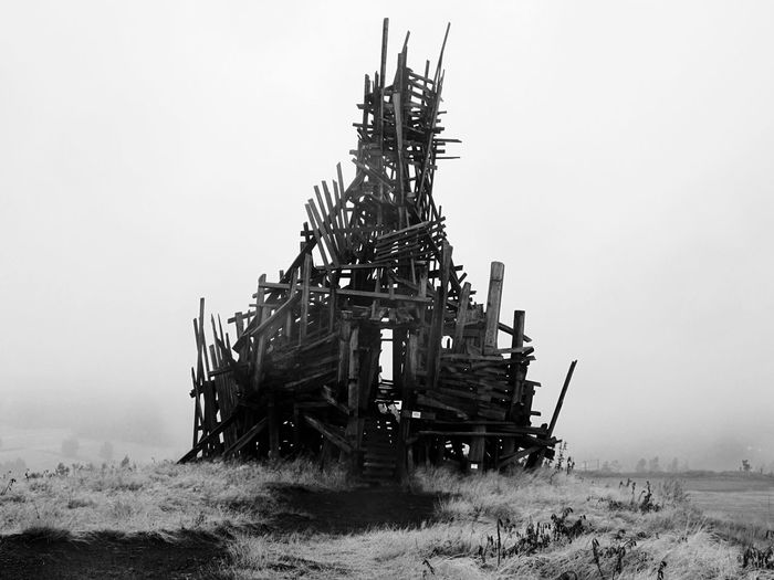 Old built structure on land during foggy weather