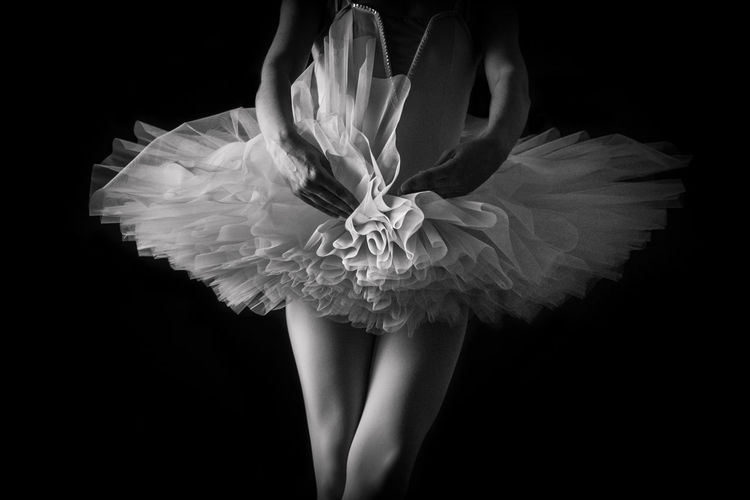 Midsection Of Ballet Dancer Against Black Background