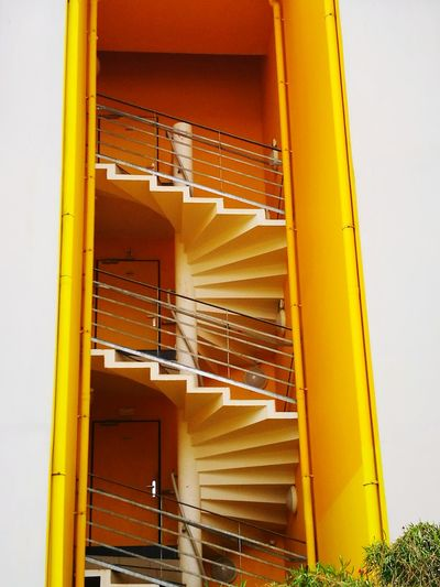 Architecture Built Structure Modern Low Angle View Yellow Building Exterior Day Spiral Staircases