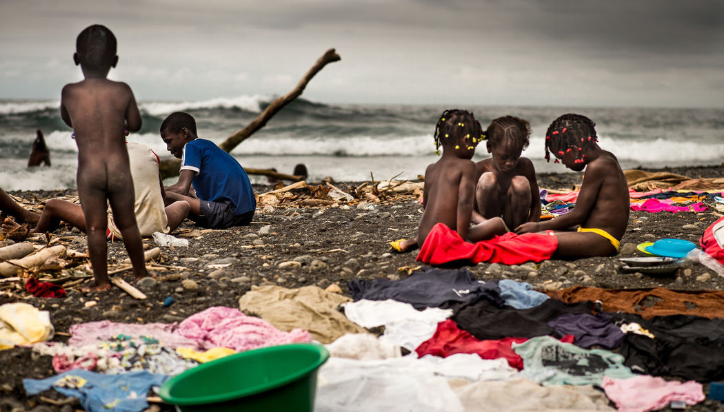African Coast Atlantic Ocean Sao Tome The Beach  The Beach Life The Week On EyeEm Africa Day To Day Beach Beachlife Black Sand Beach Clothes Grey Sky Horizon Over Water Kids At Beach Local Beach Sea Together Togetherness