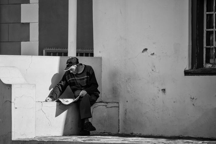 Adult Bnw_friday_eyeemchallenge Bnw_portrait Bnw_portraits Bo-kaap Bokaap Built Structure Full Length Men News Paper One Man Only One Person Outdoors Reading South Africa
