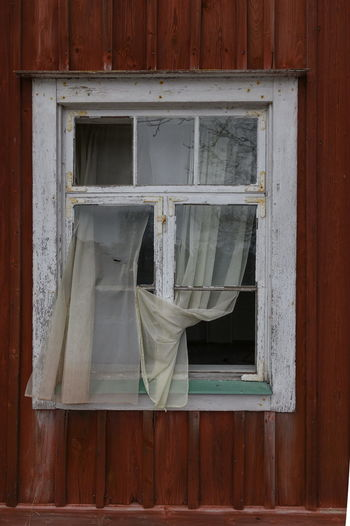 Exterior of house hanging on window of building