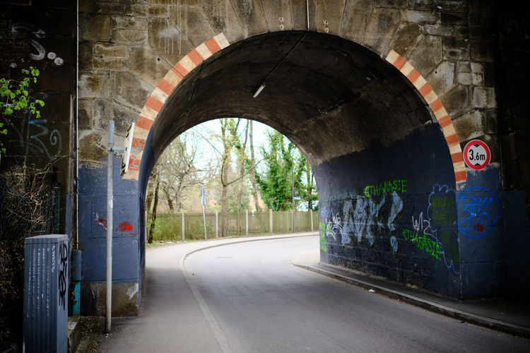 Empty road along walls and tunnel