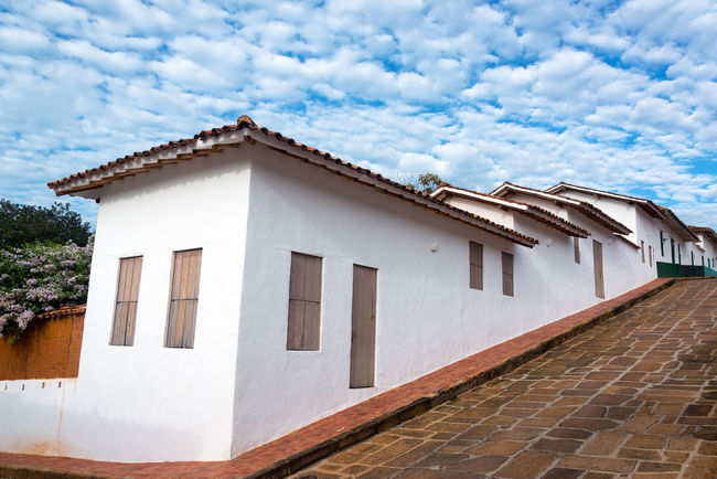 White colonial architecture and interesting sky in Barichara, Colombia Architecture Barichara Building Colombia Colonial Culture Exterior Faith Façade Historic Historical House Landmark Old Sandstone Santander Spanish Stone Street Tourism Town Travel Typical Vacation White