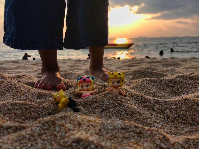 Babies sunbathing Toysoutdoors Low Section Human Leg Beach Real People Sand Sunset Two People Barefoot EyeEmNewHere EyeEm Ready