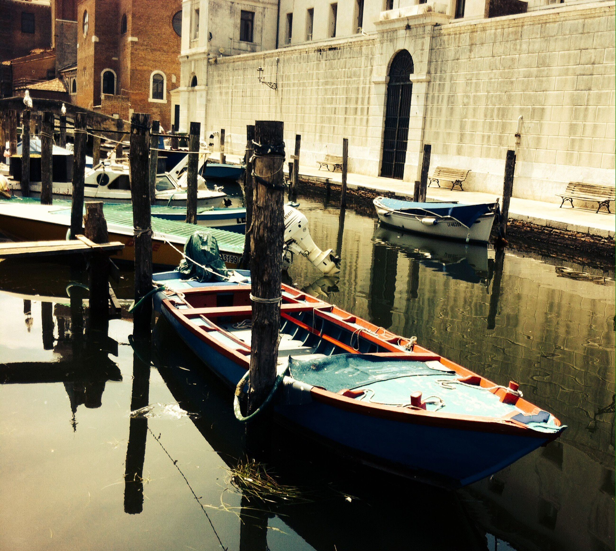 reflection, gondola - traditional boat, water, canal, building exterior, architecture, cultures, transportation, moored, nautical vessel, waterfront, outdoors, travel destinations, built structure, no people, day, gondolier