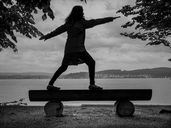 Daredevil 🏂 Shotoniphonex Mainau Island Lake Full Length Real People One Person Sport Balance Leisure Activity Sky Nature Silhouette The Photojournalist - 2018 EyeEm Awards