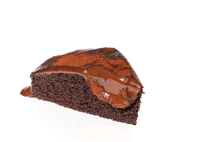 Close-up of chocolate cake against white background