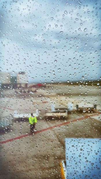 Raindrops Rain Airport View Through A Airplane Window From My Point Of View Real People Luggage Car Before Start Traveling Holidays Airplane EyeEm Gallery Real Photography Means Of Transport Runway Airfield Tarmac Taxiway Area Showcase April Selective Focus Up Close Street Photography Long Goodbye