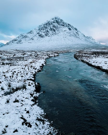 Winter snow in Glencoe, Scotland Mountain Snow Cold Temperature Winter Snowcapped Mountain Uk United Kingdom Scotland Scottish Highlands Glencoe Weather Landscape Ice River Frozen Sky Clouds