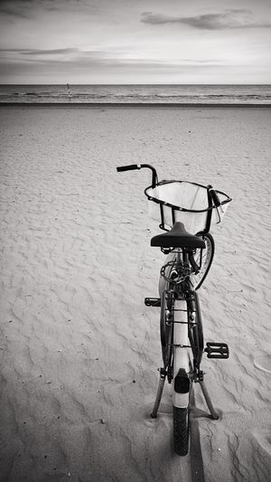 Bicycle One Standing Nobody Lonely Loneliness Seafront Beach Blackandwhite Black And White Black & White Blackandwhite Photography EyeEm Best Shots EyeEm Best Shots - Black + White Beach Sky Horizon Over Water Landscape Calm Waterfront