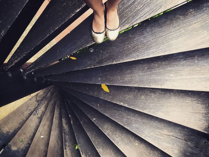 Wooden spiral staircase Wooden Stairs Spiral Staircase Low Section Human Leg One Person Human Body Part Body Part Shoe Lifestyles High Angle View Unrecognizable Person Leisure Activity Outdoors Human Foot Sunlight Day Springtime Decadence
