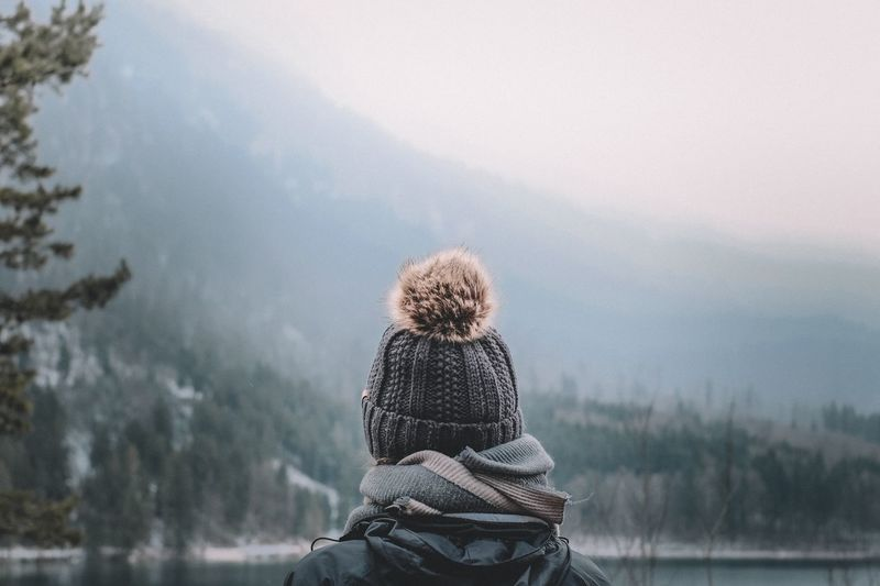 Rear view of woman looking at winter