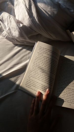 Cropped hand of woman reading book