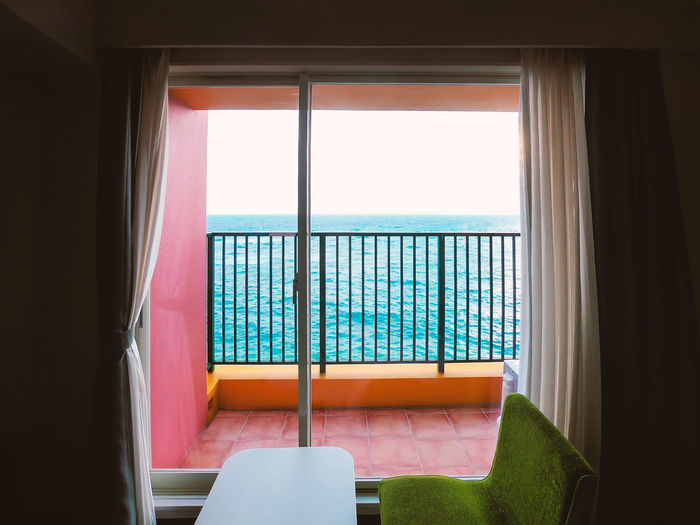 Scenery in front of the window Architecture Chair Clear Sky Day Empty Horizon Horizon Over Water Indoors  Luxury Nature No People Railing Scenics - Nature Sea Seat Sky Transparent Water Window
