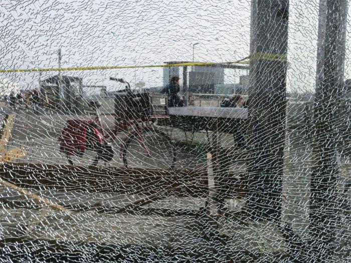Buildings seen through wet glass window