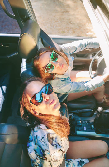 High angle portrait of friends traveling in car