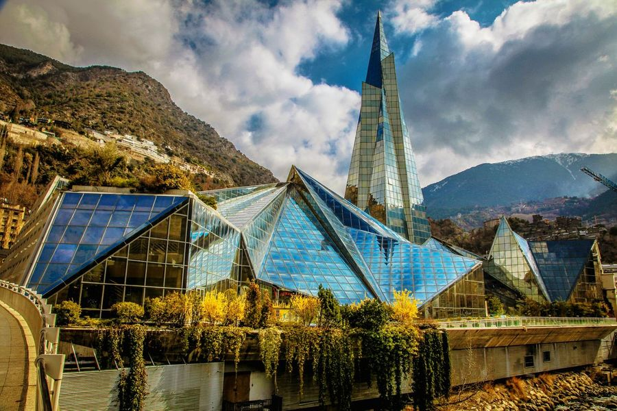 Pyramidal silhouette of thermal water Park named Caldea. Under a glass dome on an area of about 600 square meters, there are dozens of pools, baths, saunas, jacuzzis with thermal water. This healthcare complex is one of the main sightseeings of the capital Andorra La Vella Andorra Andorralavella Andorra🇦🇩 Spacenter Sky Cloud - Sky Outdoors Day No People Mountain Architecture Nature The Graphic City