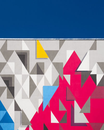 Colorfacade Multi Colored Built Structure Architecture Pattern No People Day Fujix_berlin Ralfpollack_fotografie Minimalism Minimalist Photography  Triangle Shape Blue Shape Red Sky Design Creativity Clear Sky Art And Craft Backgrounds Outdoors Geometric Shape