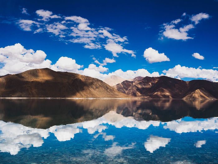 mountain & water lake refection Water Cloud - Sky Sky Scenics - Nature Reflection Lake Beauty In Nature Tranquil Scene Tranquility Mountain Nature Blue No People Day Waterfront India Photography Photo EyeEm Selects Travel Traveling Travel Destinations Travel Photography LehLadakh Adventure