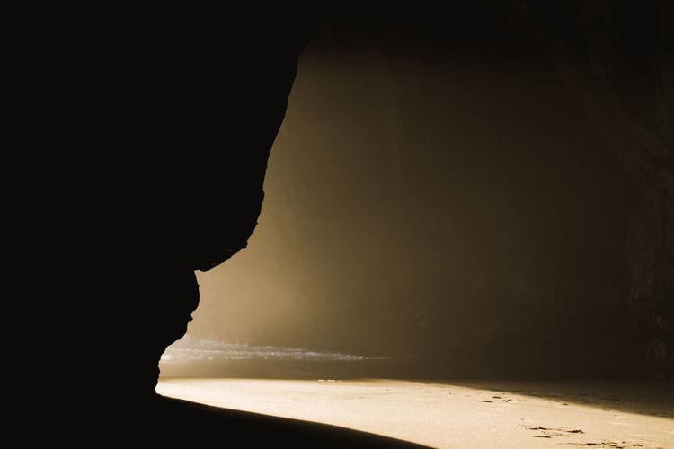 Silhouette beach by sea