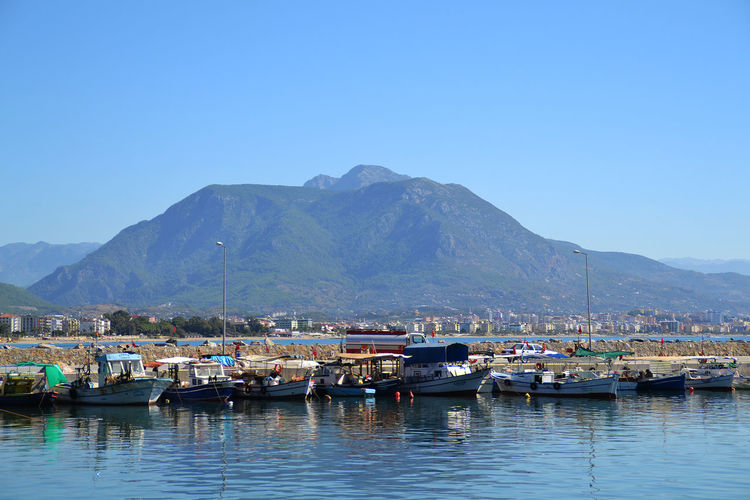Blue Boat Calm Clear Sky Day Harbor Harbour Marina Of Alany Nautical Vessel No People Passenger Craft Sailing Boats Taurus Mountains Tranquil Scene Tranquility Transportation Water
